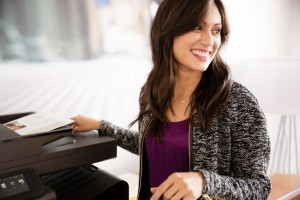 Small business owner smiling and using HP printer