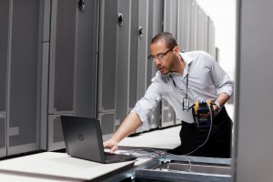 "Man working on a Z Book 14"" Notebook in a data center."